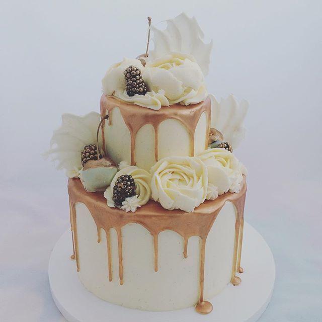 Bronzed beauty... Mini two tier white chocolate mud cake with vanilla  #twotier #weddingcake #metalliccake #metallicdripcake #dripcake