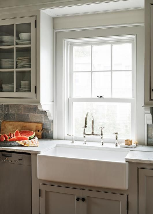 Cottage Kitchen Features Light Gray Shaker Cabinets