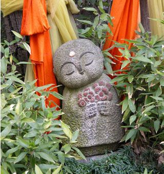 This little figure is so sweet, he is called Jizo (地蔵)  Jizo are stone images placed along pathways. They look like little monks and indeed their origin was influenced by Buddhism. But they belong more to folk beliefs. He is the protector of women, children, and travelers in the six realms of existence. Jizo is special to pregnant women and to those whose children have died.