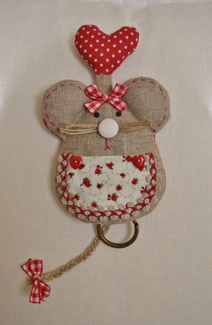 I believe this is a dish towel holder, but I just love the little mouse. (Probably would omit the heart sticking out of it`s head and the towel ring and just use it as an applique.