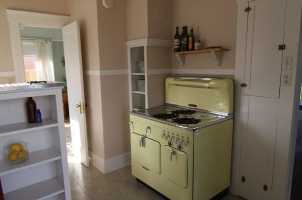 Poof! Instant Renovation! 1952 buttercup yellow Chambers gas stove.