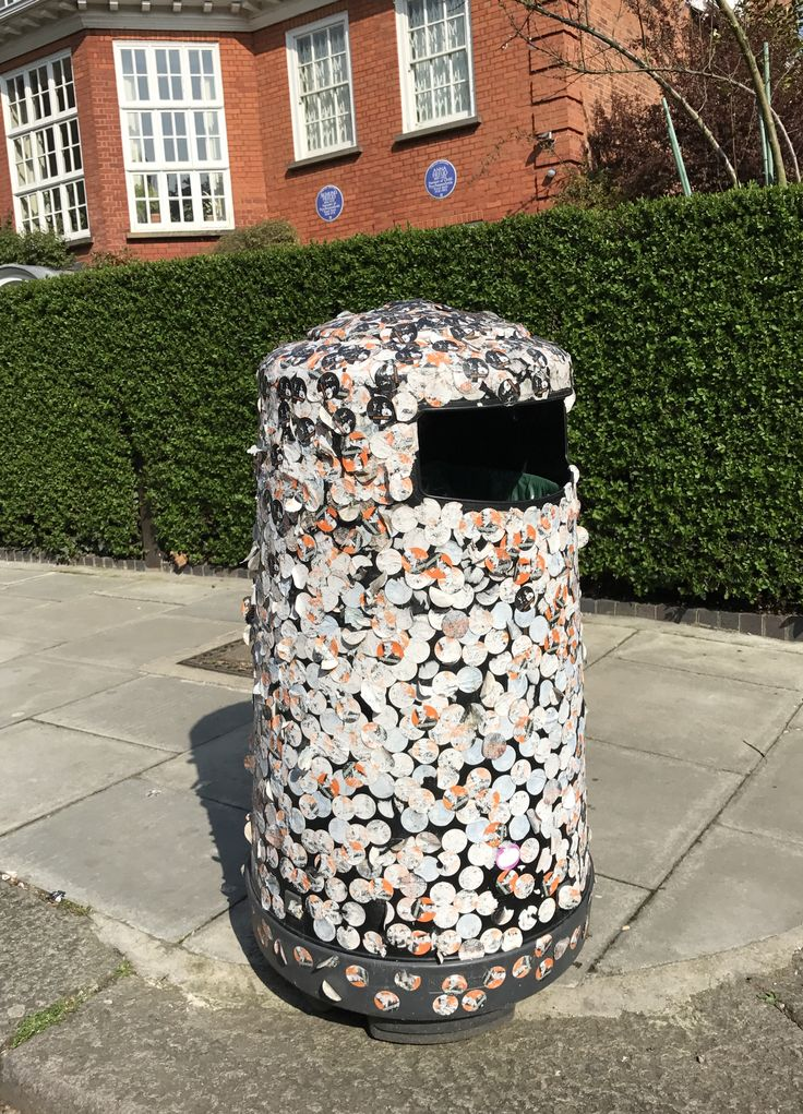 The bin outside the Freud Museum, covered in visitors' stickers.