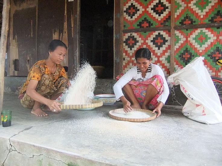 File:Traditional Sasak Village Sade two women winnowing rice 1.JPG