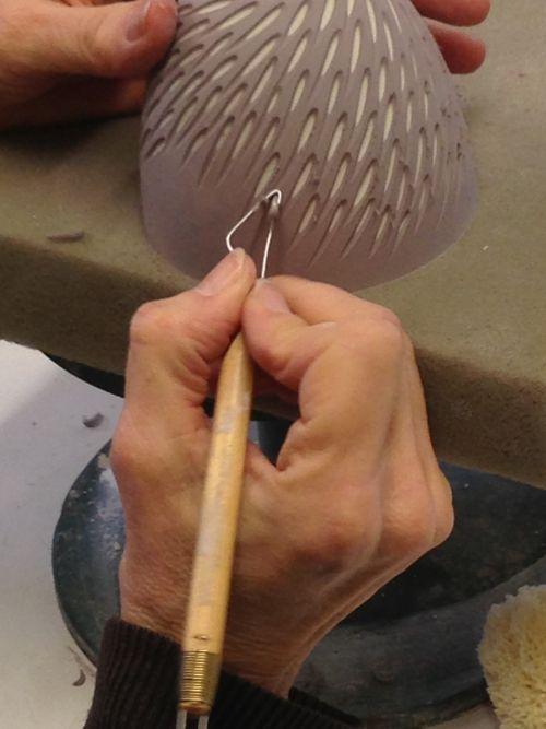 Sasha Wardell Carving a slipcast pot