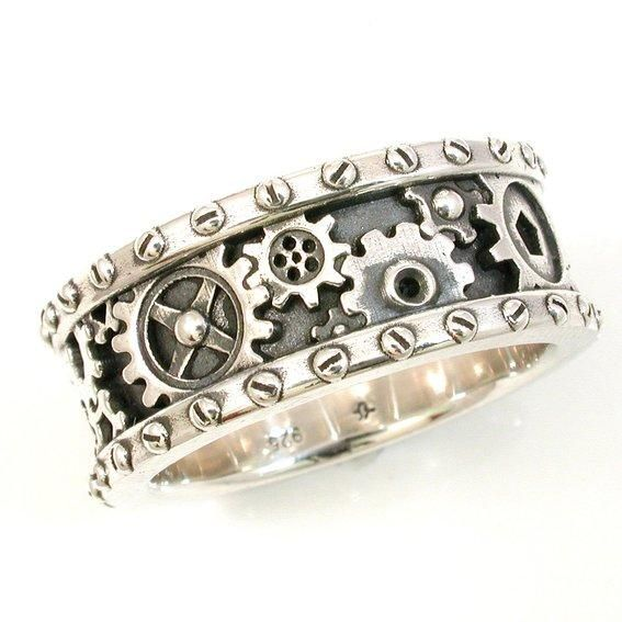 I. Must. Have it. Hold the wedding.  Steampunk men's grinding gears ring or wedding band. Check out http://www.designyourownperfume.co.uk to create your own custom fragrance to compliment your quirky Steampunk style...