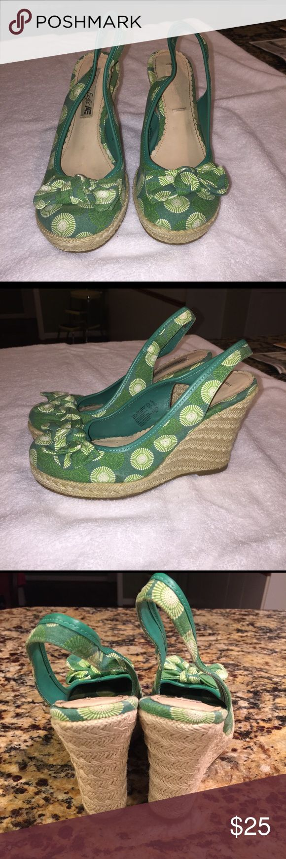 """American Eagle Espadrille Wedge Size 8 American Eagle ladies espadrille canvas sandal with 4"""" wedge, Size 8, rubber sole, and elastic inside the back strap for comfort and hold. Barely worn and sooooo cute for spring!  There is a spot on the side of one of the wedges that looks like a drop of glue possibly. Can hardly see it but I wanted to point it out. American Eagle Outfitters Shoes Espadrilles"""