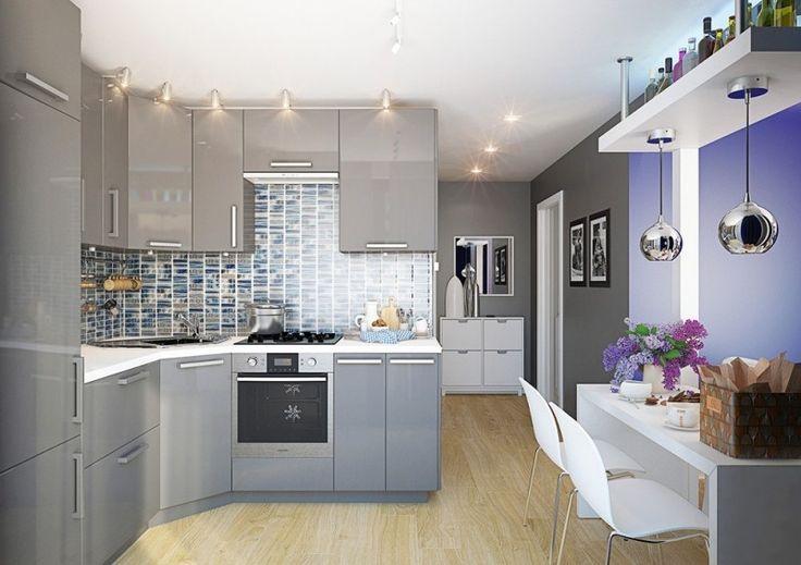 cocina con mobiliario con suelos de madera clara y gabinetes grises