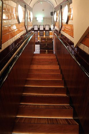 Then go down the stairs to the ticket hall. | There Is A Secret Underground Bar In London That Contains An Entire Tube Carriage