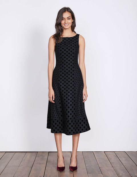 The velvety flocked spots on this dress have been cleverly placed in two different sizes for an ultimately flattering effect. The fitted bodice nips you in at the waist, before flaring into a flared skirt. We've lined the luxurious Italian-wool-blend fabric so that it's super soft against the skin too.
