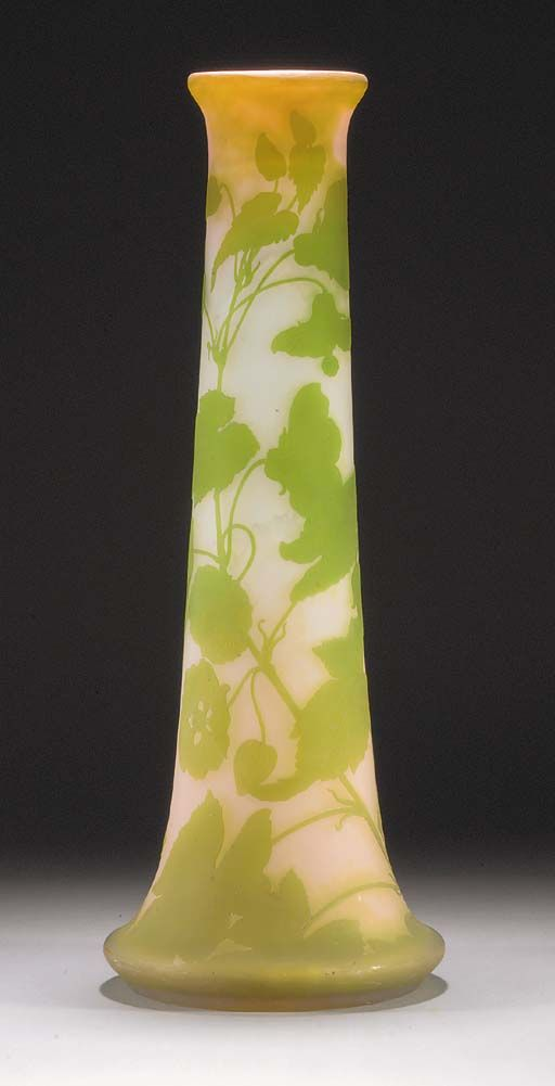 An art nouveau gallé cameo glass vase the frosted glass internally mottled with pink and green and overlaid in green etched and carved with flowers and