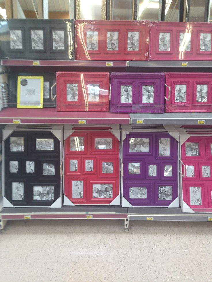 #displayshelving - perfect for displaying multiple picture frames - Free standing double sided gondola metal shelving with larger shelves and front risers to accomodate large picture frame. #usedshelving Available at Shopfitting Supplies Ltd.