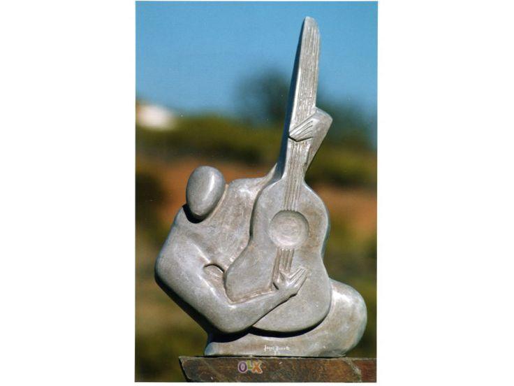 Escultura em Pedra Título: O Guitarrista