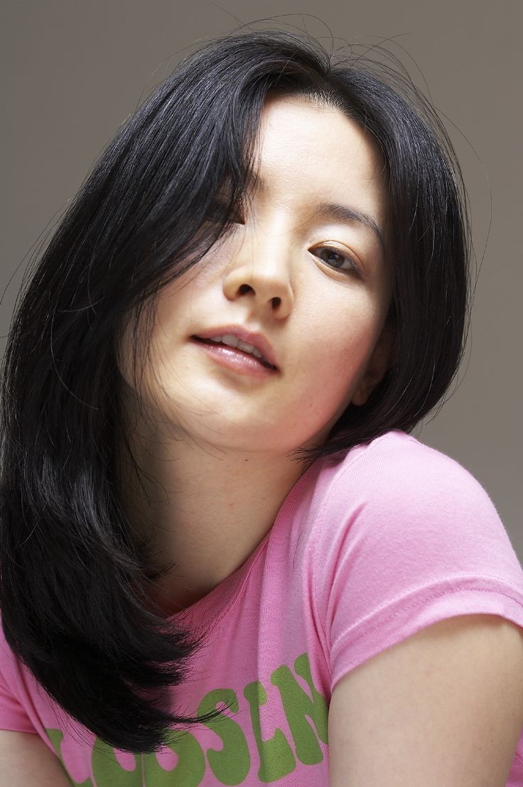 A Young Teen Girl With Long Curly Blond Hair Is Outside: Lee Young-ae (이영애)