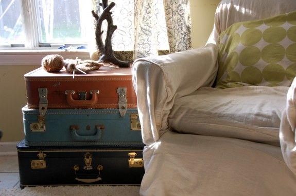 Set of Vintage Suitcases.... stacked, these vintage suitcases make a neat side table and would be added storage for items that you do not use everyday - holiday decor, greeting cards, tax receipts..... You can pick up these heavy old suitcases cheap at yardsales, auctions, flea markets.....