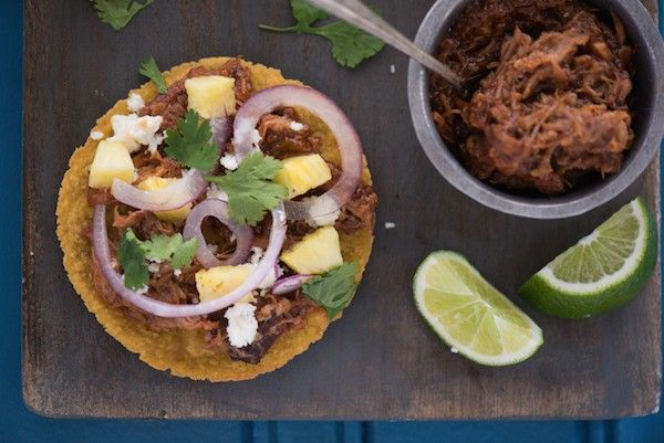 Slow Cooker Hawaiian Pulled Pork Tostadas - Few ingredients, minimal prep time, HUGE flavors! Let your crockpot do all the work for this family-friendly meal.   foxeslovelemons.com