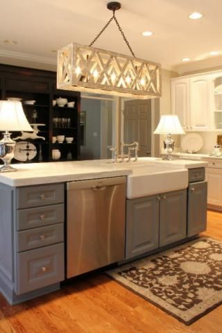 Definitely love the farmhouse sink in the island & cool chandelier