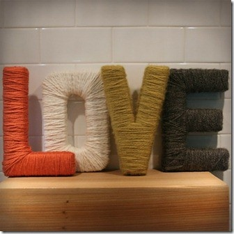 Cardboard letters wrapped in yarn