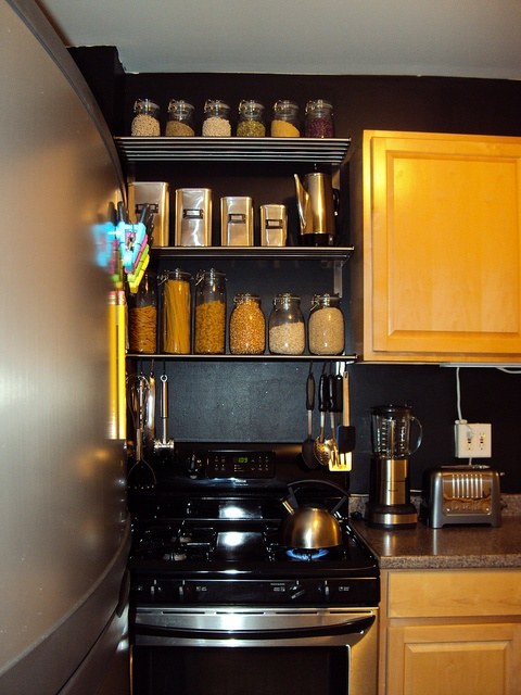organized spices shelving rack above stove instead of that unnecessary cabinet we never use. useful and decorative.