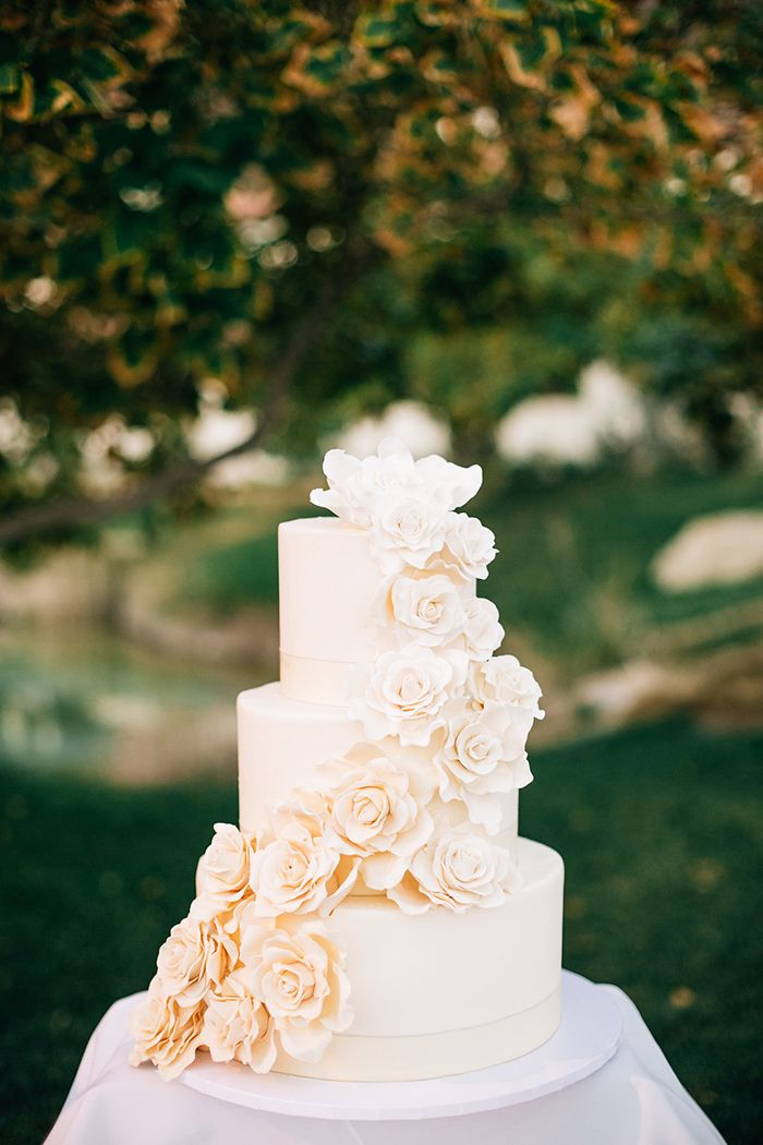 Lovely white and peach ombre wedding cake