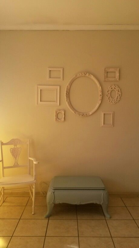 Bedroom wall decorated with picture frames painted with white chalkboardpaint. Love it!