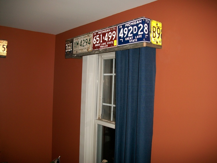 Cute for a little boys room and we have lots of old license plates. barn lumber valance covered with old license plates