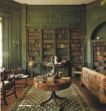 I love this Green painted living room with wall-bookcases, amazing space.