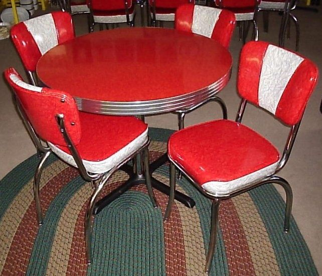 a vintage 1950's formica and chrome dinette set with a
