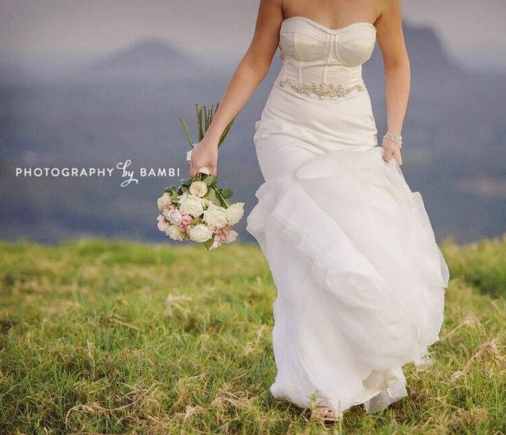 Beautiful shot of our Bride with her divine bouquet by 'Photography by Bambi'