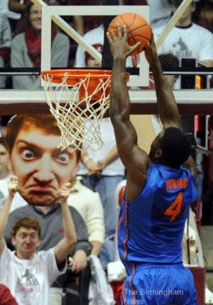 Distract the opposing team with a giant photo of your face... Funniest sign ever