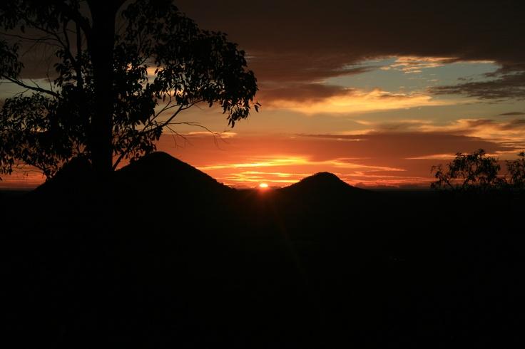 Sunrise over the Glasshouse Mountains from Uluramaya Retreat Cabins 2012.