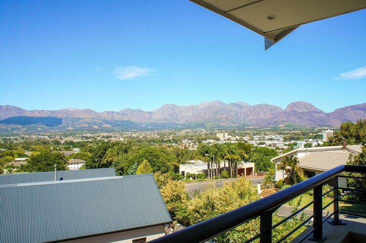 Stunning views can be seen of the Paarl Valley from this balcony of this luxury  property in Paarl, South Africa.