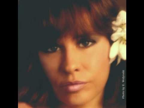 The Girl from Ipanema with Stan Getz, Astrud Gilberto and Joao Gilberto.  Written by Antonio Carlos Jobim.