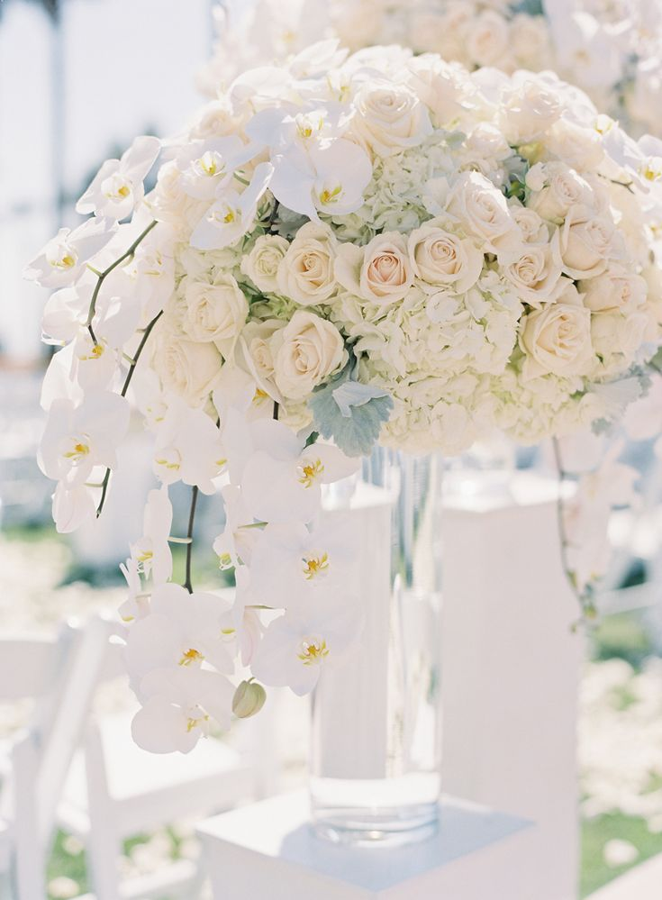 Elegant monochrome tall wedding floral arrangements for the ceremony with orchids, roses and hydrangea (Caroline Tran Photography)