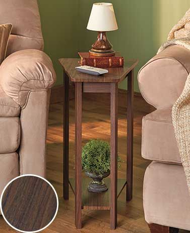 This Wedge End Table is the perfect solution for that awkward space between a couch and recliner. It has a narrow, trapezoidal shape with a shelf on the bottom