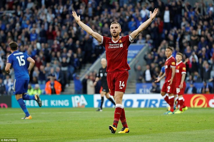 Liverpool captain Jordan Henderson appeals in vain to the assistant referee for a foul on goalkeeper Simon Mignolet