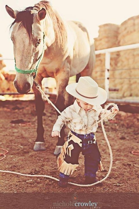 My heart just melted!!! If we have a kid I want my first one to be a boy sooooooo bad. Little Blake or Blain.....Cute little cowboy with horse