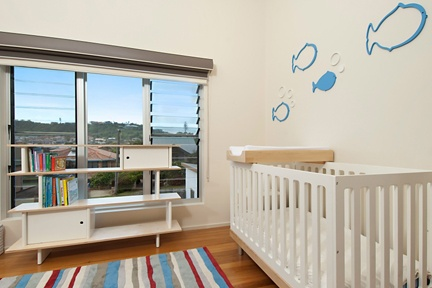 Beech and white painted timber furnishings are ideal for this light filled nursery by the beach.  http://www.kidsindesignedspaces.com.au/residential/babyproject2