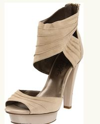 The platform and heel are wrapped in glossy patent for stylish contrast along with a chic boost.