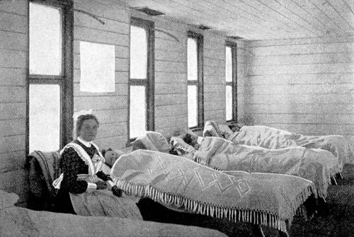 Scarlet fever hospital, 1903, A fever hospital, originally intended to be only temporary, was set up in 1860 in the Dunedin suburb of Caversham. It is shown here in 1903, when a scarlet fever epidemic swept through New Zealand, killing at least 131 people. These are some of the six girls who were quarantined in the hospital.