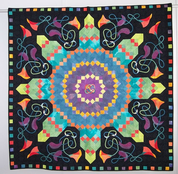 Octet Center by Elsie Vredenburg.  The center design was taken from an antique quilt. Celtic style stems and flowers were added in the open spaces.