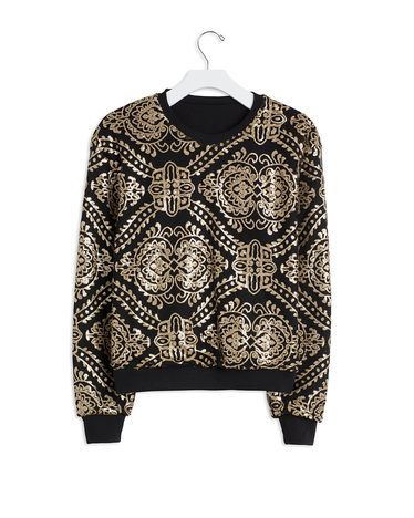 Black and White Sweater.  Great with skinny jeans.