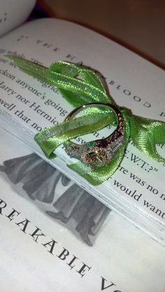 engagement ring in a Harry Potter book. | But I by no means condone the cutting-up of an HP book. I think I'd be crying over the book instead of the proposal. :P