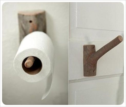 a branch-turned-hook can be used to hold your toilet paper