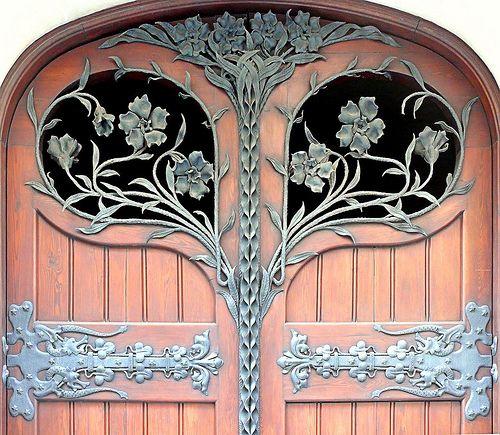 aDOORation | detailed arched door in Barcelona, Spain | Bayer Built Woodworks