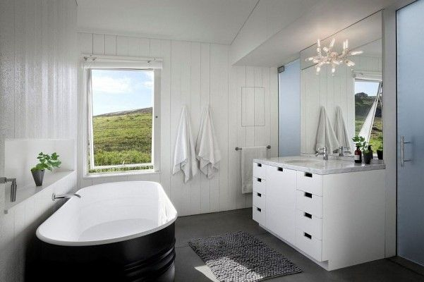The Duravit Tub Functions Almost As A Hot Tub And Used Primarily For Soaking In And Relaxing At Dusk And But It Has The Ease Of A Bathtub With The Water Drains To A Greywater System That Irrigates The Surrounding Landscape And A Valuable Feature In Drought Hit California With Small Eclectic Kids Bathroom In Dc Metro With A Wall Mount Sink And A Claw Foot Tub And A Shower/bathtub Combo And A One Piece Toilet And Porcelain Tile And Gray Walls And Mosaic Tile Floors And Black And White Tile…