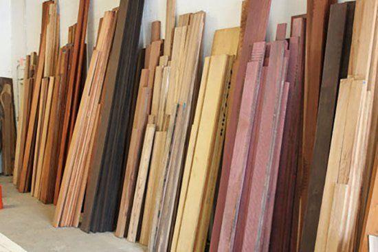 hardwood lumber against wall in home improvement store #homeimprovementguide, #homeimprovementstores,