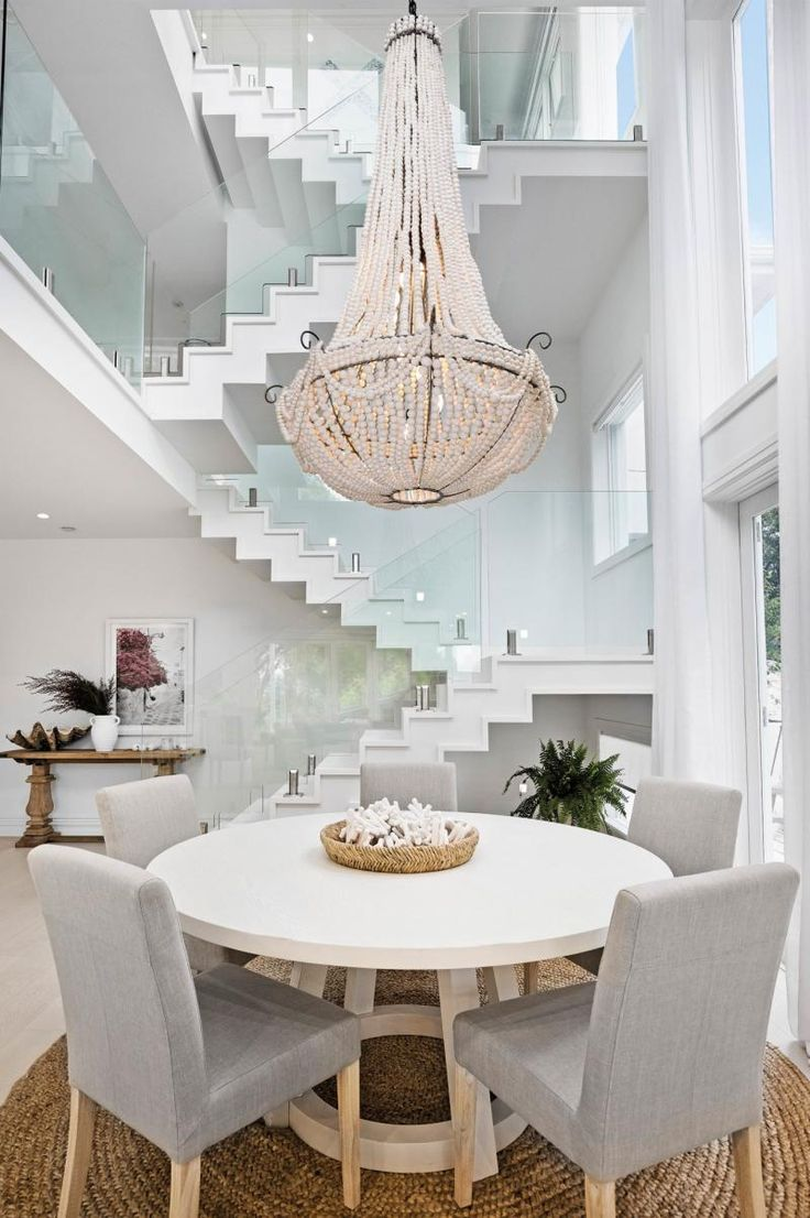 Three Birds Rennovations: a white Santorini-style home made for luxury living.