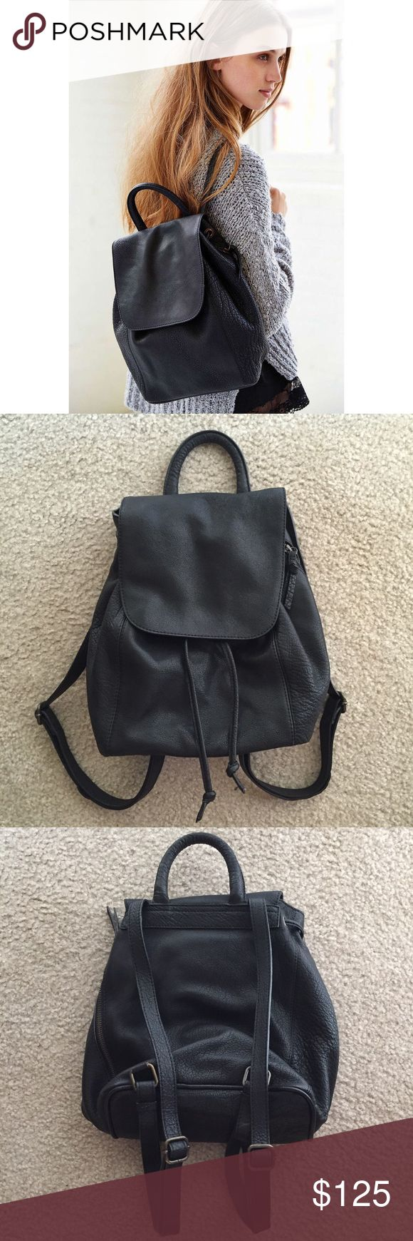 """Urban Outfitters Black leather backpack NWOT Great condition Adjustable straps Real leather which is thick and sturdy Very roomy and trendy 13"""" x 9.2"""" Fits iPad 2/3/4/MacBook perfectly Brand is silence + noise from Urban outfitters Sold out everywhere  Price is firm No trade $100 plus shipping on Ⓜ️ and Vinted  Check out my closet! Brandy Melville John Galt Forever 21 American Eagle American Apparel Urban Outfitters Charlotte Russe Hollister Aeropostale Minkpink Nasty Gal Topshop Free people…"""