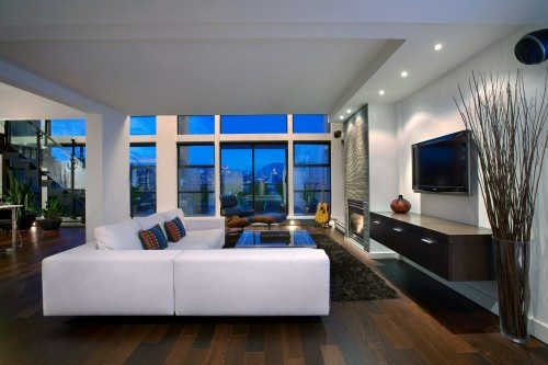 living room - white leather sectional couch, floating cabinet