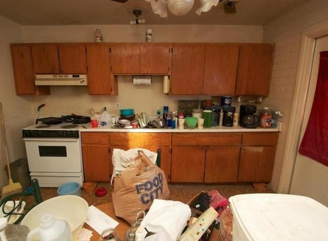 cluttered messy kitchen cabinets too much stuff on counters poor bad home staging Mesa Arizona house for sale